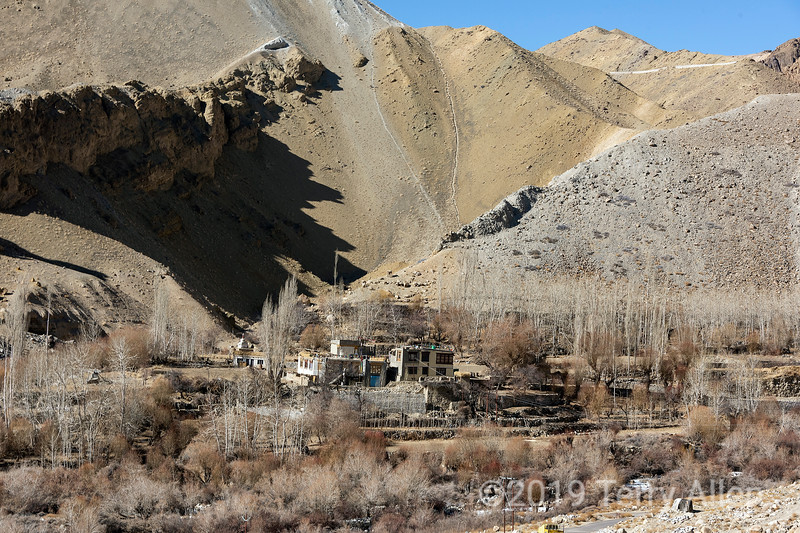 Houses and stupa along the Ulley Road in the winter, Ladakh