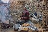 Ladakh woman making bread over a dung fire, Ullay, Jammu and Kashmir, India