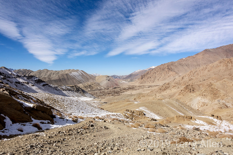High valley, blowing clouds and small village near Fotu La, Ladakh