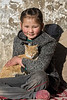 Portrait of a Ladakh girl with her cat; Ulley, Ladakh