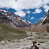 Yann getting his shoes wet crossing glacial streams near Mount Gumbarajon