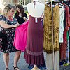 Alysia Pfeifle checks out some clothing during Ladies Night Out in Leominster on Thursday evening. SENTINEL & ENTERPRISE / Ashley Green