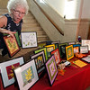 Sue McHale sells her artwork during Ladies Night Out in Leominster on Thursday evening. SENTINEL & ENTERPRISE / Ashley Green