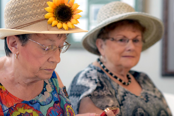 Gerry Thoman of Effingham, left, and Joyce Wenthe of Watson don hats for the Ladies' Tea Party at Effingham County Museum.<br /> Cathy Griffith photo
