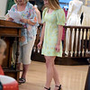 Jane Ries describes a mini dress from the 1970s Isabelle Daiber is wearing during the Ladies' Tea Party at Effingham County Museum. The dress was made by Ries' mother, Rhea Cooley Loy. Ries wore it in 1971 at Effingham High School.<br /> Cathy Griffith photo