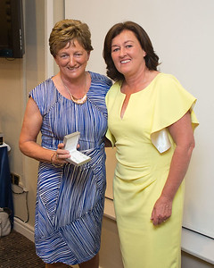 Angela Heffernan who came 4th, with her prize   presented by Lady Captain Grace