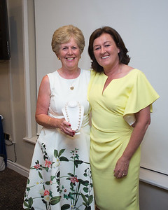 Geraldine Cassidy  winner of the Lady Captain's  Prize  receives her prize from Lady Captain Grace