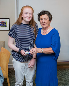 Karina Costello, Winner (Best Score 1st Day) in the Lady Captain's Prize receives her prize from Lady Captain Miriam