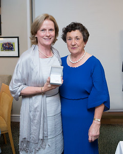 Nora Dodd, Winner (Division 3) in the Lady Captain's Prize receives her prize from Lady Captain Miriam