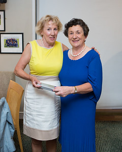 Jean Bonus, Winner (2nd Day Nearest The Pin) in the Lady Captain's Prize receives her prize from Lady Captain Miriam