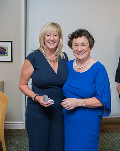 Noreen Breen, Runner-Up (Division 2) in the Lady Captain's Prize receives her prize from Lady Captain Miriam