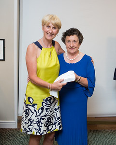Tina Meehan, Gross Prize winner  in the Lady Captain's Prize  receives her prize from Lady Captain Miriam