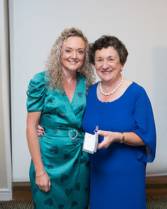 Marie Redmond, Winner (1st Day Longest Drive) in the Lady Captain's Prize receives her prize from Lady Captain Miriam