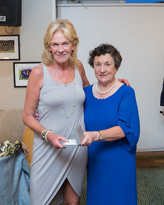 Roz Sparks,  Winner (Division 1) in the Lady Captain's Prize receives her prize from Lady Captain Miriam