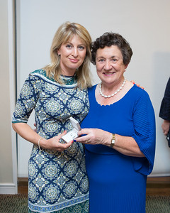 Ruth Marie, Winner (Best Score 2nd Day) in the Lady Captain's Prize receives her prize from Lady Captain Miriam