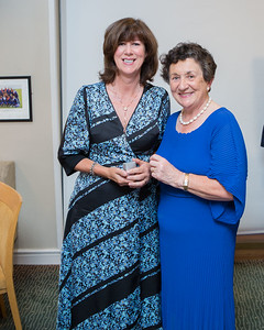 Breda Hopkins, Runner-Up (Division 3) in the Lady Captain's Prize receives her prize from Lady Captain Miriam