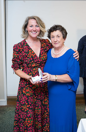 Leslie Stevens, Winner (Division 4) in the Lady Captain's Prize receives her prize from Lady Captain Miriam