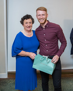 Luke Byrne, Winner of Lady Captain's Prize to Men receiving his prize from Lady Captain Miriam