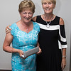 Angela Heffernan receiving the Past Captains' Prize from Tina