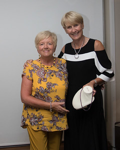 Anne Hughes receiving her prize (Ladies 9-Hole) from Tina