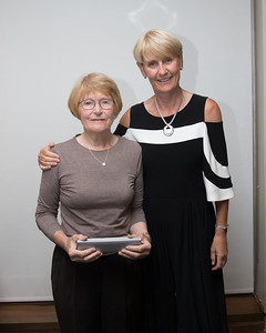 Sheila Whitaker receives her prize (17th-Nearest Pin) from Tina