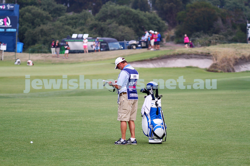20-2-15. LPGA Handa Australian Women's Golf Open, Royal Melbourne Golf Club. Round 2. Laetitia Beck's caddy Trevor Stevens. Photo: Peter Haskin