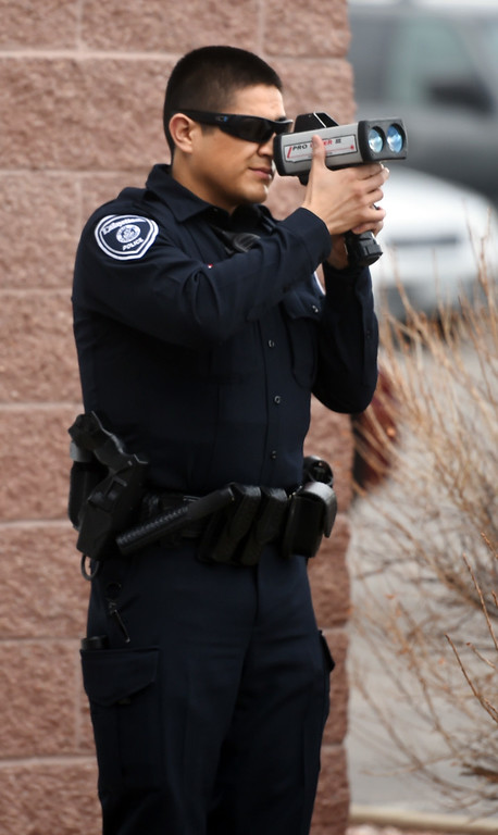 . Lafayette Police Officer, Luis Carrazco, checks his equipment before going out on patrol. Lafayette Police Officer, Luis Carrazco, takes a Daily Camera photographer on a ride along on January 10, 2018.  Cliff Grassmick  Photographer January 11, 2018