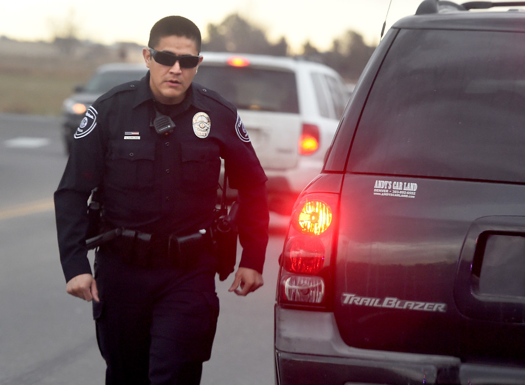 . Lafayette Police Officer, Luis Carrazco, makes a traffic stop while on patrol. Lafayette Police Officer, Luis Carrazco, takes a Daily Camera photographer on a ride along on January 10, 2018.  Cliff Grassmick  Photographer January 11, 2018