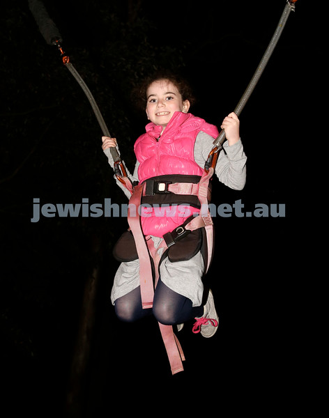 Lag B'Omer at Chabad North Shore. Dina Lowinger on the bungee trampoline. Pic Noel Kessel.
