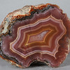 "#0640 Laguna Agate, Estacion Ojo Laguna, Chihuahua, Mexico<br /> The hairline crack in this agate has completely turned to solid agate and is not a flaw, you can see the color of the filing changing as it goes from one area to the next. Classically sharp Laguna banding and a bright orange ring in the center.<br /> 2 3/4 x 2 1/4 x 1 3/4"" 0.58 lb<br /> All agates in the sample galleries have been SOLD."