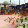 Saw this beautiful mural, everyone was taking photos straight on.  Looked around and I was these flowers invading into the stone bench.  I used it as a foreground to reduce the white space in front of the mural.  The only issue is the building and palm trees behind the mural.  I guess I can photoshop them out.  But I don't do that.