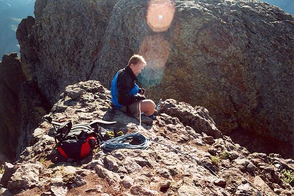 Preparing to rappel into Coxcomb's summit ridge notch