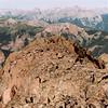 Lookingdown Coxcomb's summit ridge toward cleft (top center photo)