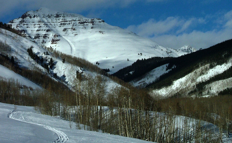 Teocalli Mountain (13,208 ft, rank 478) blocks all but the top of 14,265 foot Castle Peak (rank 12) while skiing up West Brush Creek; Elk Mountains, Colorado.