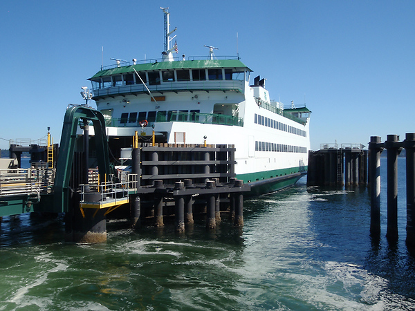 The ferry getting ready to unload vehicles and passengers.