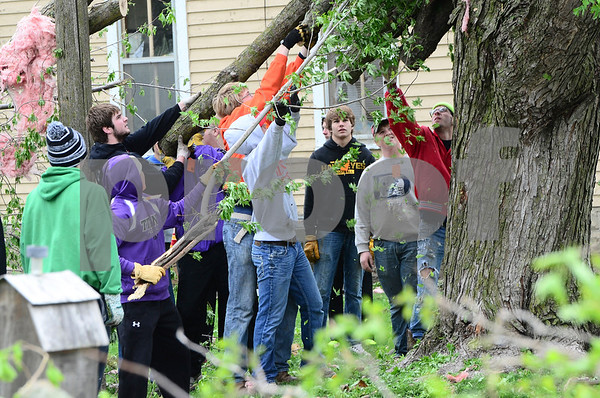 -Messenger photo by Jesse Major<br /> <br /> Dozens of students from South Central Calhoun High School helped removed debris from yards on Monday after a tornado ripped through Lake City Sunday night.