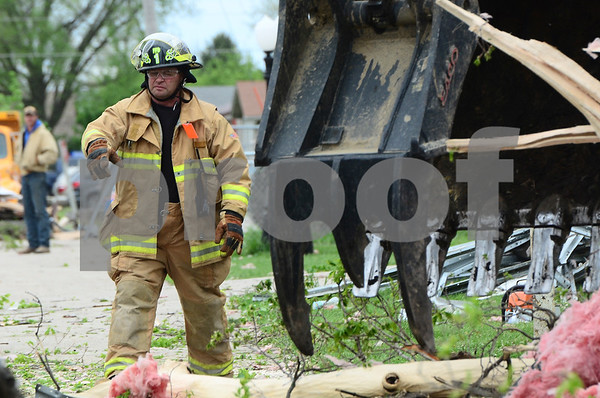 -Messenger photo by Jesse Major<br /> <br /> Farnhamville fire chief Jay Anderson gives directions as a debris is cleared from South Central Calhoun High School.