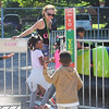 Kailee Leonard - The News-Herald <br> Young attendees run excitingly to their seats on one of the rides at the Lake County Fair, July 25.