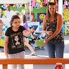 Kailee Leonard - The News-Herald <br> Attendees play ball toss on the midway, Tuesday 25, in hopes to win a prize at Lake County Fair.