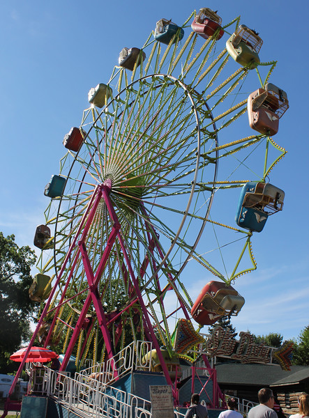 Kailee Leonard - The News-Herald <br> An oldie but goodie, the ferris wheel stands tall at the end of the midway at Lake County Fair.