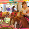 Kailee Leonard - The News-Herald <br> One young attendee takes a spin on the Pony Ride Express, Tuesday July 25, at the Lake County Fair.