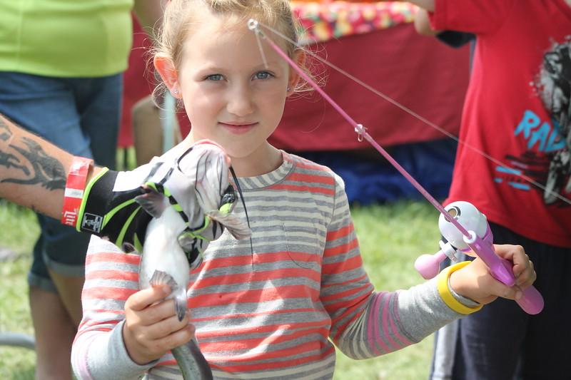 Kristi Garabrandt - The News-Herald <br /> Parker Warmington, 6, of Chardon holds the catfish she cat while fishing at the First Bite Fish Tanks at the Lake County Fair.