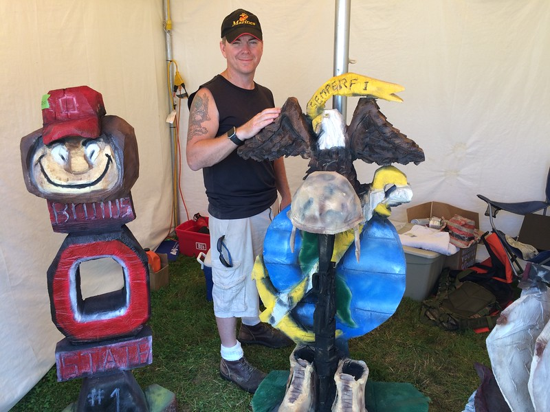 "Chad Felton — The News-Herald <br> Chain saw artist Mark Hannah, aka, ""Insane Chain"" at the Lake County Fair on July 27."