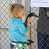 Kailee Leonard - The News-Herald <br> Laurel Willman holds her duck 'Hillary Clinton', Tuesday July 25, at the Lake County Fair.