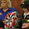 Kristi Garabrandt — The News-Herald <br> Maribeth Shankman President of the Women's Auxilary for the American Legion Unit 678 and Connie Sorrell Auxillary President for Willowick-Eastlake VFW Present the Wreath at EastLake's Veteran's Day ceremony.