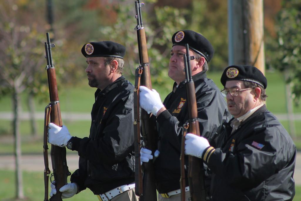 . Kristi Garabrandt � The News-Herald <br> Members from Mentor VFW post 9295 prepare for a 21 gun salute during Mentor\'s Veterans Day Program.