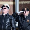 Kristi Garabrandt — The News-Herald <br> Mentor VFW Post 9295 members Ron Samcik and Rudy Baitt salute the flag during the playing of Taps.