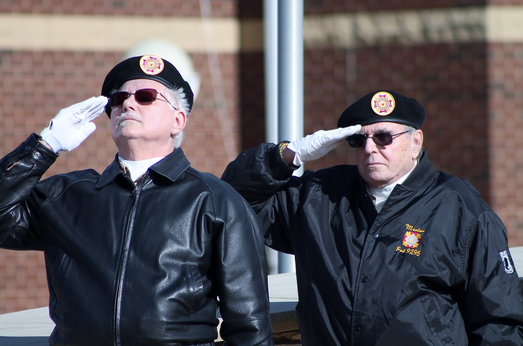 . Kristi Garabrandt � The News-Herald <br> Mentor VFW Post 9295 members Ron Samcik and Rudy Baitt salute the flag during the playing of Taps.