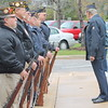 Kristi Garabrandt — The News-Herald <br>  Members of the Willoughby Eastlake American Legion and The Willowick Eastlake VFW line up outside City Hall to perform a fire salute at Eastlake's Veteran's Day ceremony.​