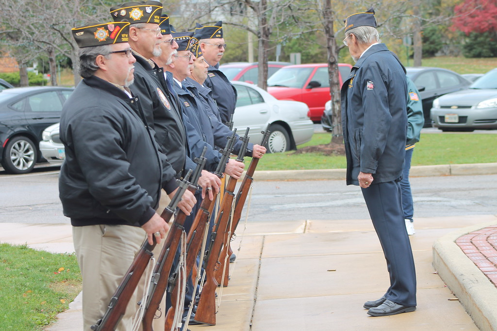 . Kristi Garabrandt � The News-Herald <br>  Members of the Willoughby Eastlake American Legion and The Willowick Eastlake VFW line up outside City Hall to perform a fire salute at Eastlake\'s Veteran\'s Day ceremony.�